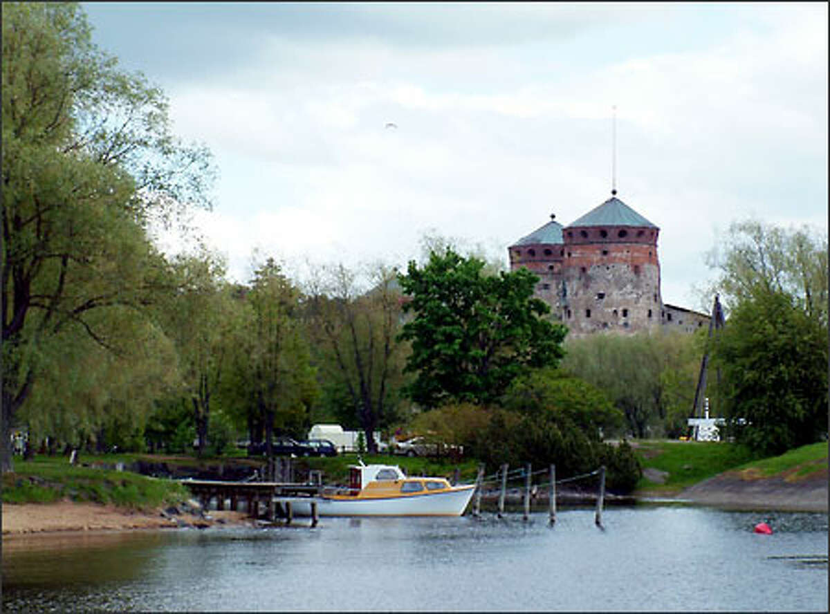 Olavinlinna Castle rises out of the lake near Savonlinna, Finland. The castle was built in 1475 as a defense against invading Russians. These days music fans and tourists are the invaders, flocking to the castle yearly for a popular opera festival.