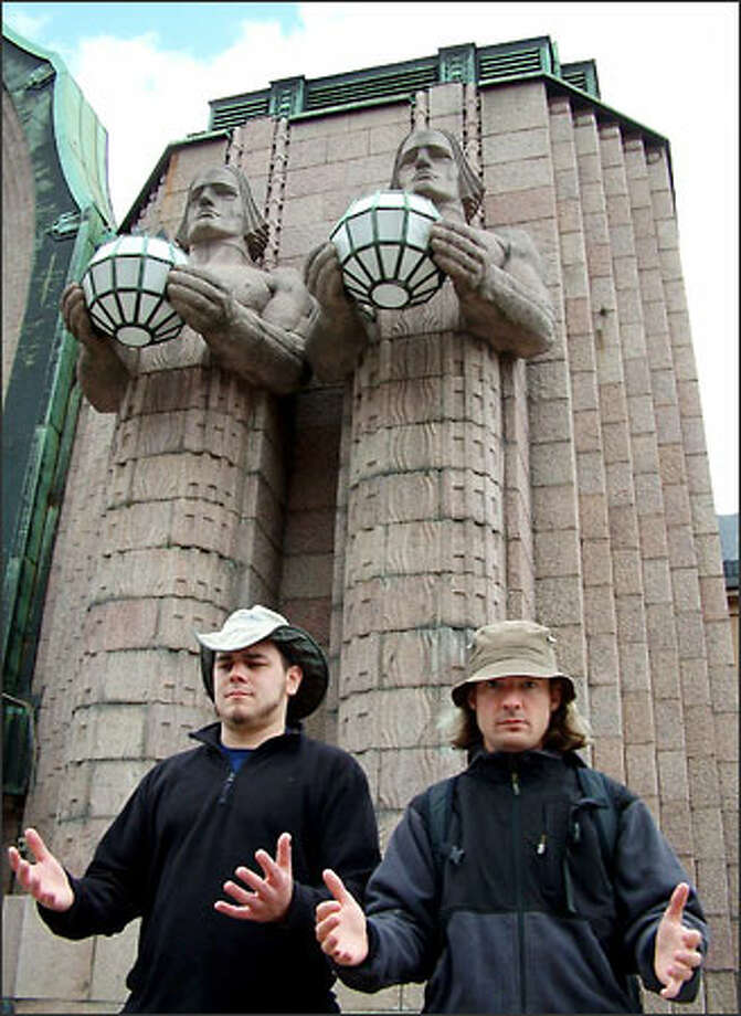Boys and their...er...balls. Friend and fellow Seattleite Stefan Schachtell joins Richie beneath Helsinki Train Station's striking statues. This elegant station was designed by Eliel Saarinen and completed in 1914. Stefan and his girlfriend Jackie Schultz joined us in Helsinki. Together we exited Finland on a train bound for Russia. Photo: Winda Benedetti, Special To Seattle Post-Intelligencer / Special to Seattle Post-Intelligencer