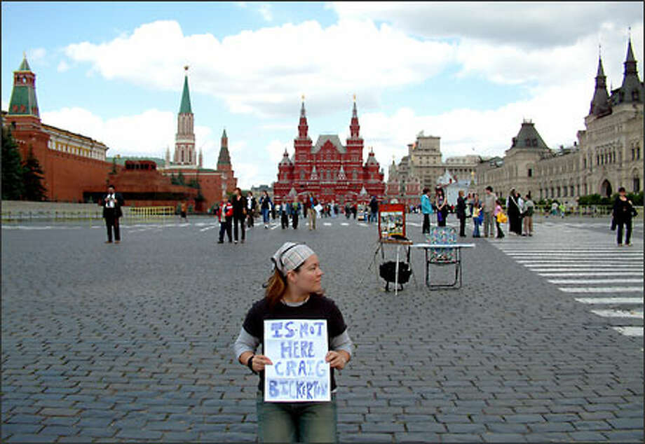 From the middle of Moscow's Red Square, Jackie Schultz of Seattle sends a teasing message (albeit an accidentally mixed up message) to a friend back home. Throughout Russia's tumultuous history, Red Square has been the site of many demonstrations and military parades. It's bordered here on the right by the state-run GUM department store and on the left by the walls of the Kremlin and the mausoleum where Lenin's body is displayed. The State History Museum rises behind Jackie. Photo: Winda Benedetti, Special To Seattle Post-Intelligencer / Special to Seattle Post-Intelligencer