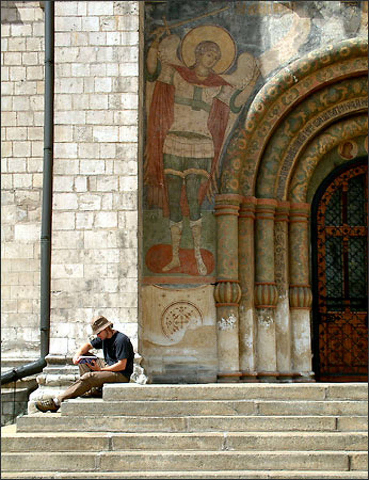 Richie relaxes on the steps of the Assumption Cathedral inside the Kremlin. The walled Kremlin is not only the seat of Russian political power but with its many churches and cathedrals it is also the heart of the Russian Orthodox Church. The Assumption Cathedral is the final resting place for many of the church's leaders.