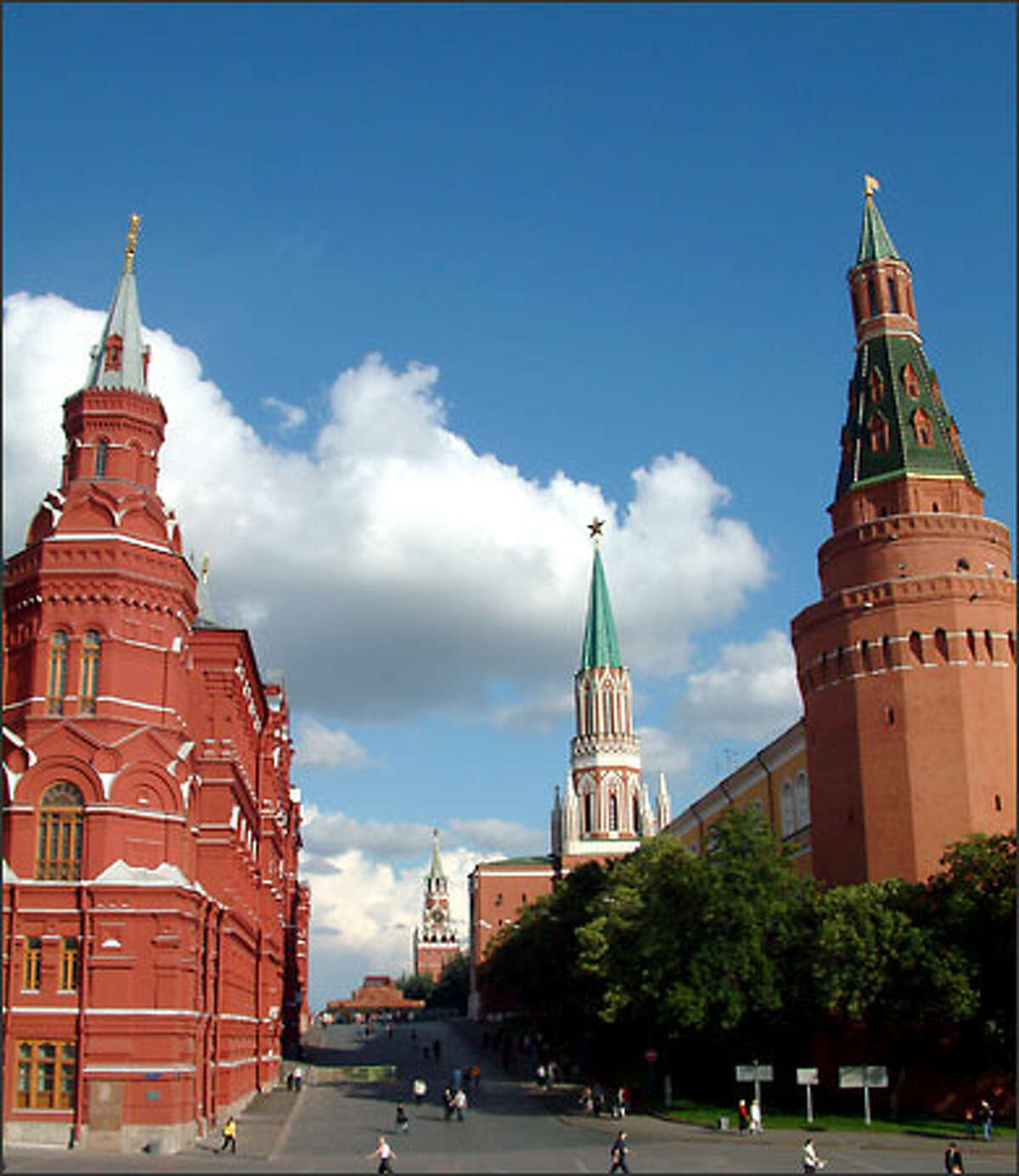 The walls of the Kremlin (right) and the State History Museum (left) give Moscow a rather striking center. The fortified Kremlin is the long-standing center of Russian power. The first walls were erected in the 1100s and were wooden at the time. Today 1½ miles of towering walls surround this historical place. But you don't need an invading army to get inside, only a tourist ticket.