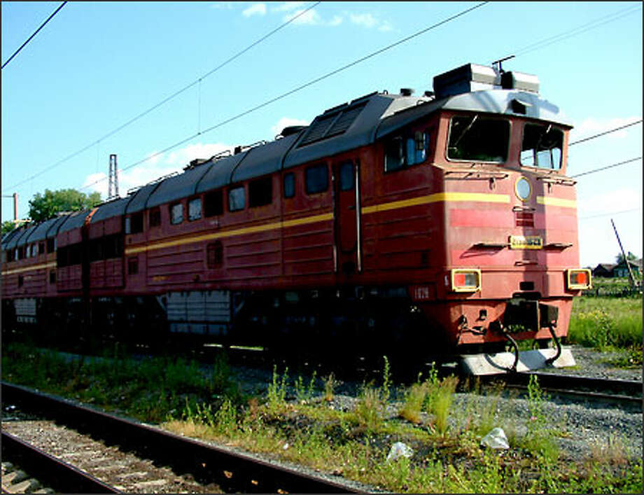 A Russian train waits to begin its Trans-Siberian trip. This famous long-haul train journey begins in Moscow and finishes in Vladivostok. It is a 5,759-mile journey that crosses the largest country on the planet not to mention something like a third of the globe. The trek takes seven days if done in one straight shot. But that hardly seemed like a good way to see Russia. Richie and I chose, instead, to stop at several points along the way. Photo: Winda Benedetti, Special To Seattle Post-Intelligencer / Special to Seattle Post-Intelligencer