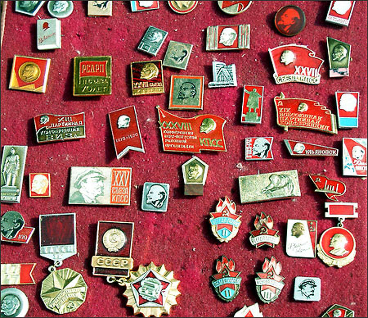 Communist leader Vladimir Lenin does somersaults in his grave as today's post-Soviet Russians peddle over-priced pins bearing his image to western tourists at a market in Yekaterinburg.