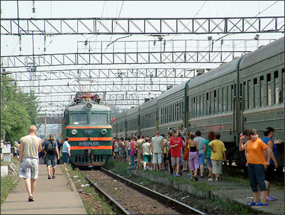 Trans-Siberian trains stop just long enough to give passengers a chance to step off, stretch their legs and stock up on food, drink and other supplies for the onward journey. Photo: Winda Benedetti, Special To Seattle Post-Intelligencer / Special to Seattle Post-Intelligencer