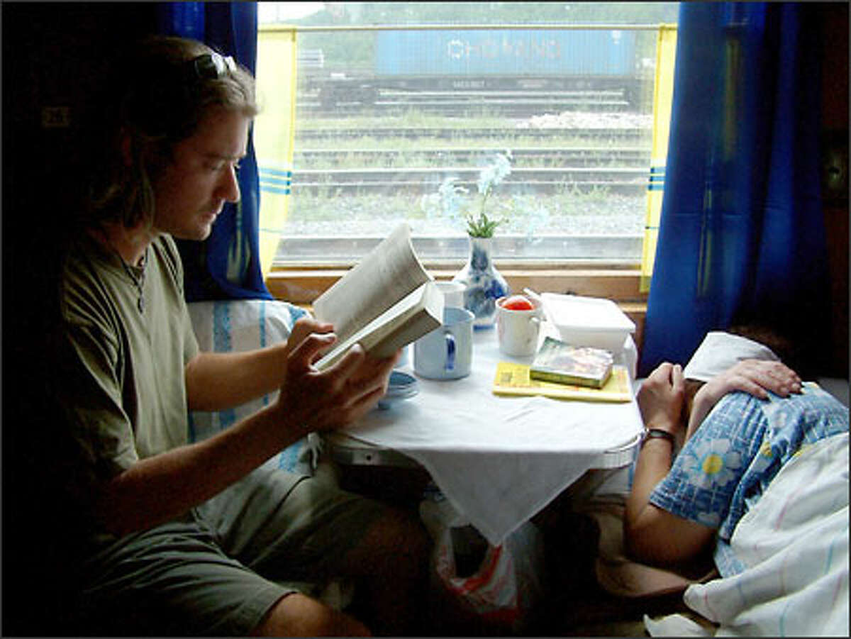 You have a lot of time to kill when riding the rails across Russia. It's a good time to catch up on two things: reading and sleeping. Here, Richie catches up on the former while one of our compartment mates catches up on the latter.
