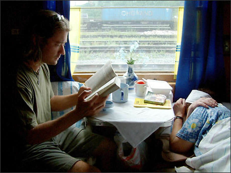 You have a lot of time to kill when riding the rails across Russia. It's a good time to catch up on two things: reading and sleeping. Here, Richie catches up on the former while one of our compartment mates catches up on the latter. Photo: Winda Benedetti, Special To Seattle Post-Intelligencer / Special to Seattle Post-Intelligencer