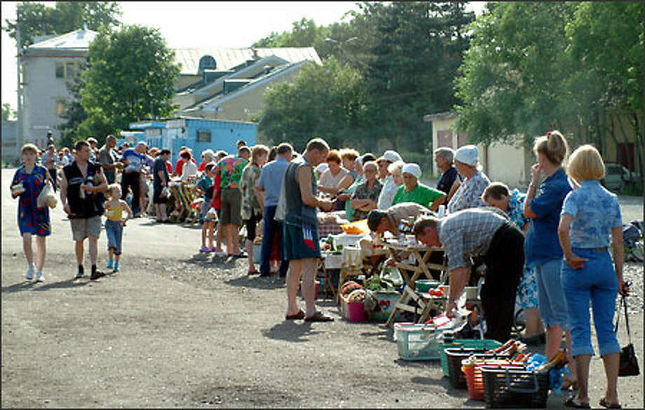 Vendors line up to sell all manner of snacks and drinks to hungry train passengers. We were amazed by the array of items sold by local townspeople on the station platforms - fresh-picked berries, boiled eggs, sunflower seeds and baked chickens were most common. During a stop at a town called Vekovka (home to a glassware factory), hawkers roamed the platform hawking (no joke) chandeliers, gargantuan brandy glasses and flower vases. Photo: Winda Benedetti, Special To Seattle Post-Intelligencer / Special to Seattle Post-Intelligencer