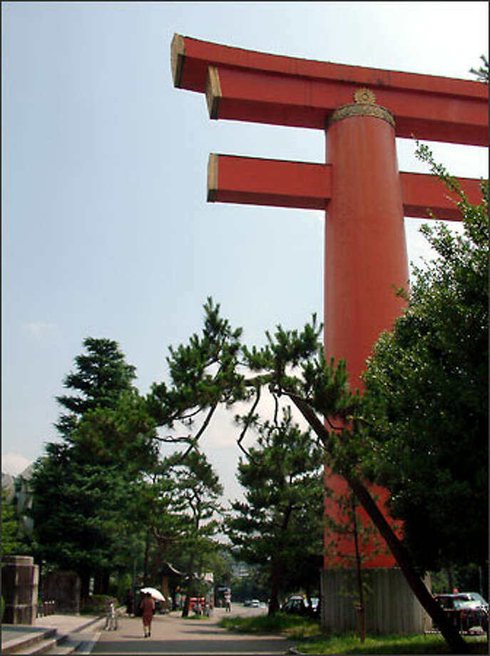 A giant steel torii (Shinto shrine gate) towers over Kyoto just outside the Heian-jingu shrine. Photo: Winda Benedetti, Special To Seattle Post-Intelligencer / Special to Seattle Post-Intelligencer