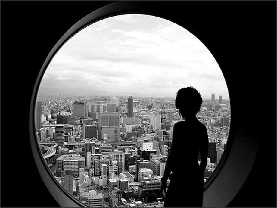 Winda looks down on the endless metropolis of Osaka from the top of the Umeda Sky Building. Japan is a strange mixture of grey metropolis sprawl and beautiful natural beauty. Photo: Richie Costleigh, Special To Seattle Post-Intelligencer / Special to Seattle Post-Intelligencer