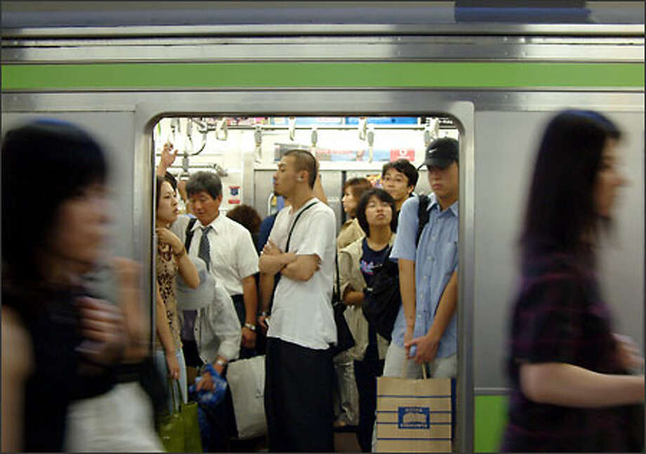 If you need personal space don't even think about venturing into Tokyo's metro system at rush hour. Many multiple millions of people use the city's trains and subways every day. And just when you think your carriage couldn't possibly fit one more person, you'll have to make room for six more people determined to cram themselves aboard. Some three million passengers pass through Shinjuku Station (Tokyo's busiest) each day. Photo: Winda Benedetti, Special To Seattle Post-Intelligencer / Special to Seattle Post-Intelligencer