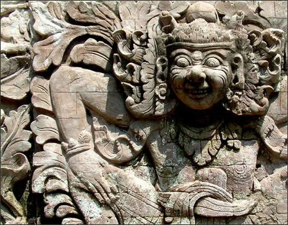 "One of the many stone carvings that adorn the intricately-decorated temple called Pura Beji in northern Bali. The word ""pura"" means temple. This temple is dedicated to a goddess who protects rice fields. Photo: Winda Benedetti, Special To Seattle Post-Intelligencer / Special to Seattle Post-Intelligencer"