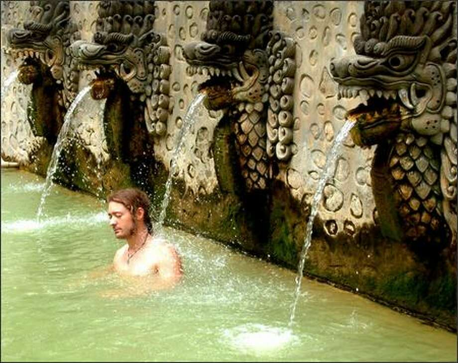 In northern Bali, stone carved naga (mythical serpents) feed warm water from a natural hot spring into pools at Banjar. Photo: Winda Benedetti, Special To Seattle Post-Intelligencer / Special to Seattle Post-Intelligencer