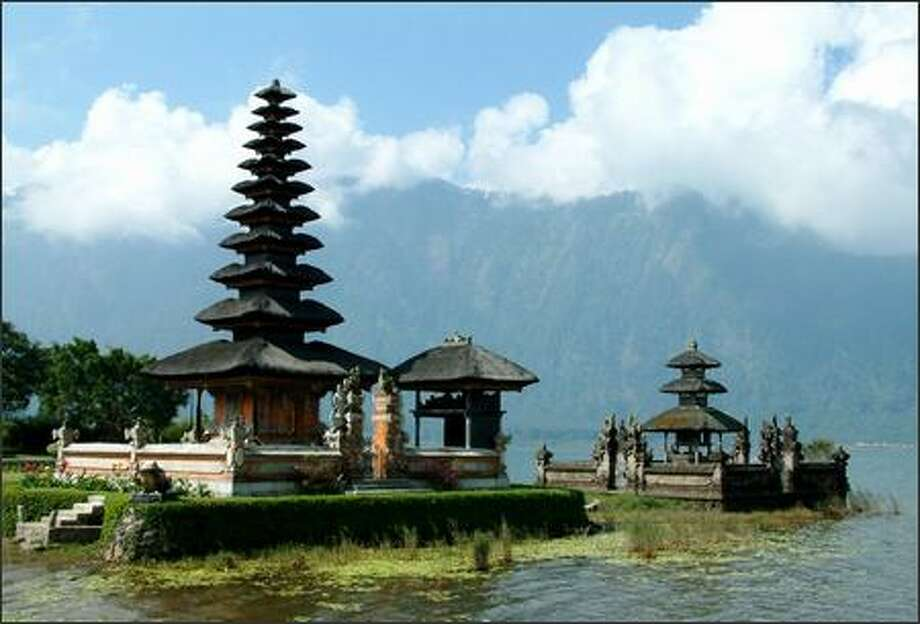 Perched on a lake in the mountains of central Bali, Pura Ulun Danu Bratan is a Hindu-Buddhist temple dedicated to the goddess of water Dewi Danu. Although the population of Indonesia is predominantly Muslim in faith, the island of Bali is an enclave of mostly Hindus and some Buddhists. Photo: Winda Benedetti, Special To Seattle Post-Intelligencer / Special to Seattle Post-Intelligencer