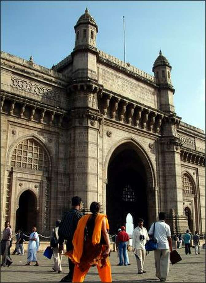 The Gateway of India on Mumbai Harbor is a popular hang out spot for tourists and locals alike and is always bustling with sightseers, beggars, balloon sellers, con artists and holy men (or at least those claiming to be holy men). A bomb detonated by Muslim extremists exploded here a week before Richie and I arrived in India. It was one of two bombs that detonated that day (the second in Zaveri Bazaar), killing 53 people. By the time we arrived, the Gateway of India was bustling and busy as ever. Photo: Winda Benedetti, Special To Seattle Post-Intelligencer / Special to Seattle Post-Intelligencer
