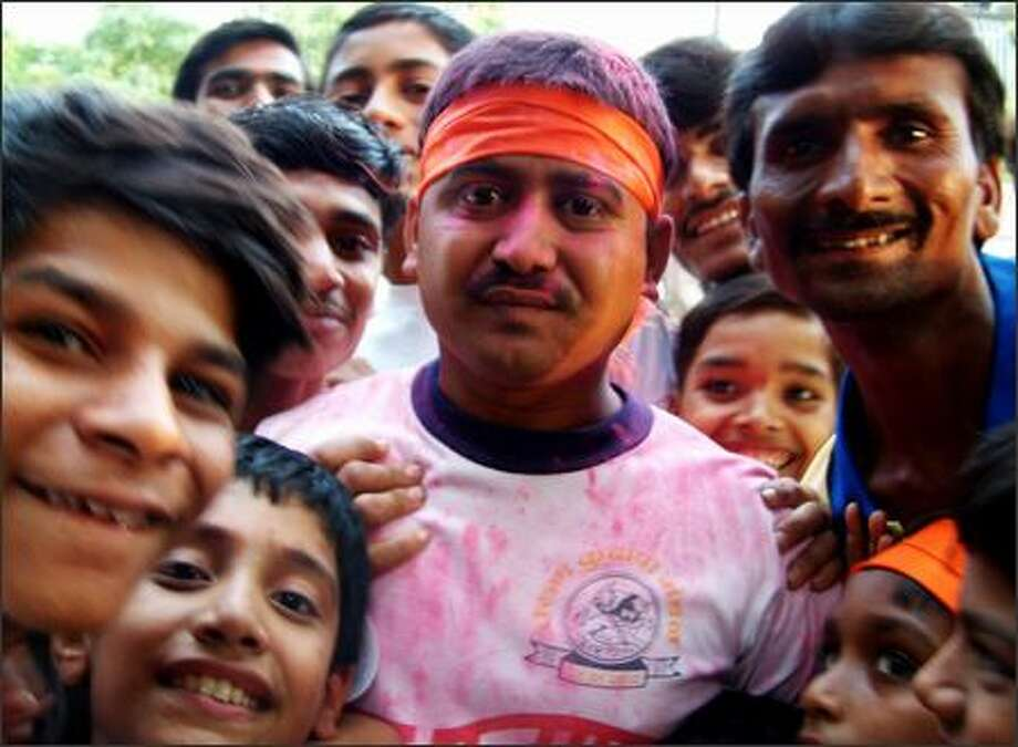 More than 80 percent of Indians are Hindus by faith and the Ganesh festival is a time for raucous celebration. Richie and I arrived in Mumbai to find the streets filled with people dancing and playing music. In the nearby city of Jalgaon we were literally mobbed by celebrants excited to have us join in the revelry. Colored water and powder is splattered on this man's face. It's a tradition for celebrants to throw the bright stuff at each other during festivities. Photo: Winda Benedetti, Special To Seattle Post-Intelligencer / Special to Seattle Post-Intelligencer