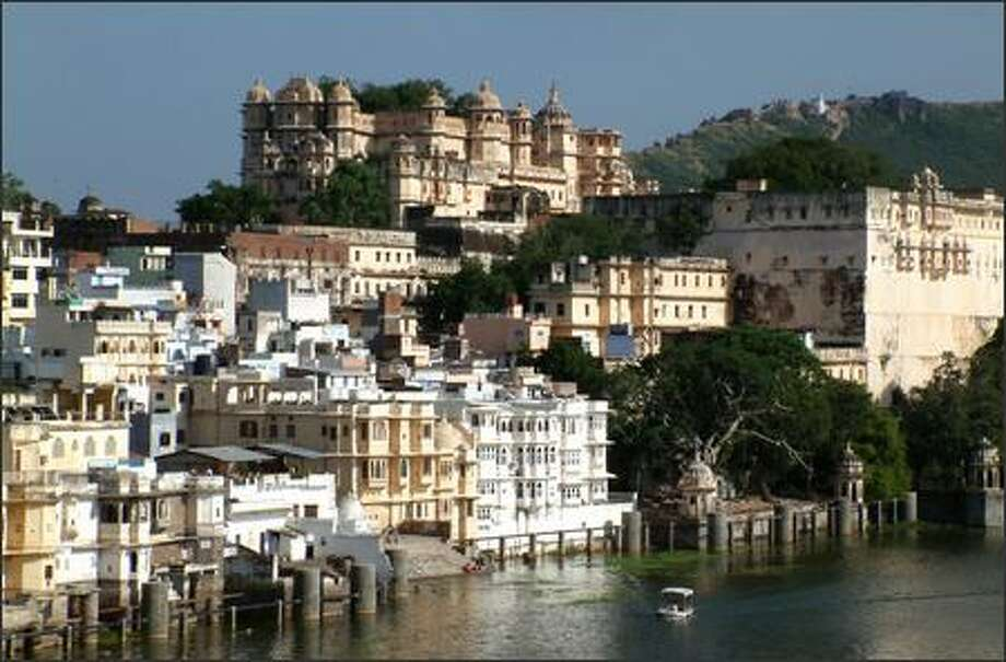"Udaipur, perched on Lake Pichola in the state of Rajasthan, was on of my favorite cities in all of India. With its bustling and labyrinthine streets, intricate buildings and the ornate City Palace (top center), it was almost exactly what I had imagined an Indian city to be like. James Bond fans also know it as one of the locations where the movie ""Octapussy"" was filmed. Photo: Winda Benedetti, Special To Seattle Post-Intelligencer / Special to Seattle Post-Intelligencer"
