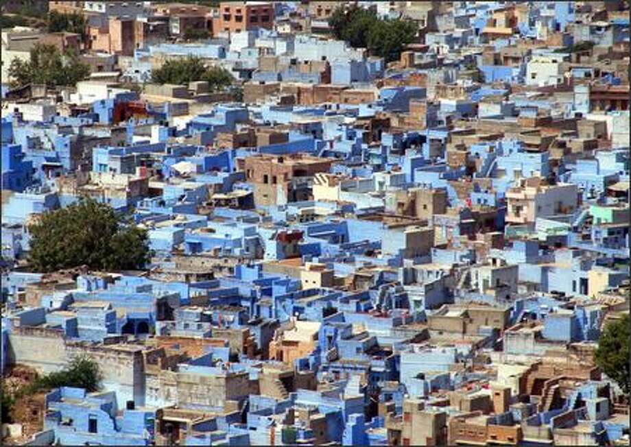 "A peek down on the city of Jodhpur gives you a good idea why it's nicknamed ""The Blue City."" Photo: Winda Benedetti, Special To Seattle Post-Intelligencer / Special to Seattle Post-Intelligencer"