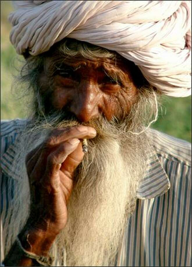 A Rajasthani elder enjoys a late-afternoon smoke. The cotton head wrap is a traditional clothing item still worn today, especially by the men of Rajasthan. Photo: Winda Benedetti, Special To Seattle Post-Intelligencer / Special to Seattle Post-Intelligencer