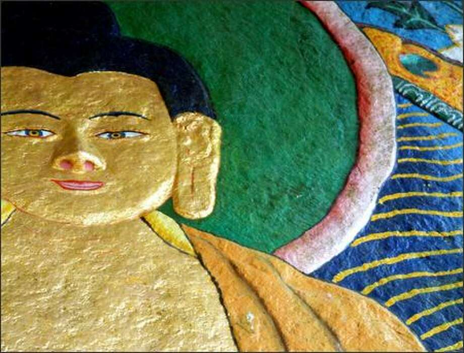 Religion is an integral part of everyday Indian life. A mural depicting Buddha adorns a rock face in the northern hill station of Dalhousie. Photo: Winda Benedetti, Special To Seattle Post-Intelligencer / Special to Seattle Post-Intelligencer