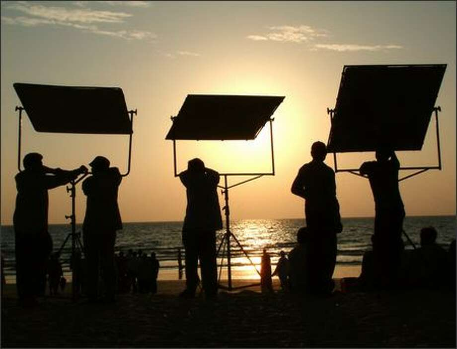 "On a late afternoon on Benaulim Beach in Goa, a film crew works on the movie ""Bride and Prejudice."" The movie, directed by Gurinder Chadha, was filmed at several locations throughout India. The film puts a Bollywood spin on the Jane Austin story ""Pride and Prejudice."" Chadha wrote and directed the semi-autobiographical flick ""Bend It Like Bekham."" Photo: Winda Benedetti, Special To Seattle Post-Intelligencer / Special to Seattle Post-Intelligencer"
