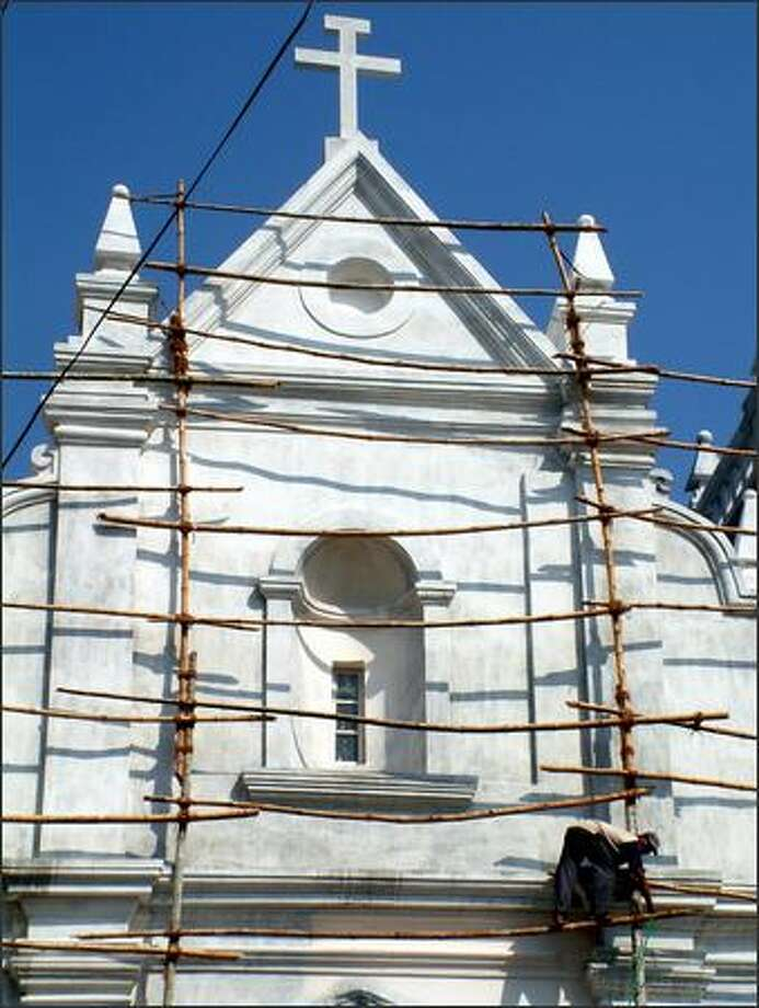 A catholic church in the city of Old Goa gets a cleaning. This beachy state, once controlled by the Portuguese, remains a Catholic enclave even today. Photo: Winda Benedetti, Special To Seattle Post-Intelligencer / Special to Seattle Post-Intelligencer