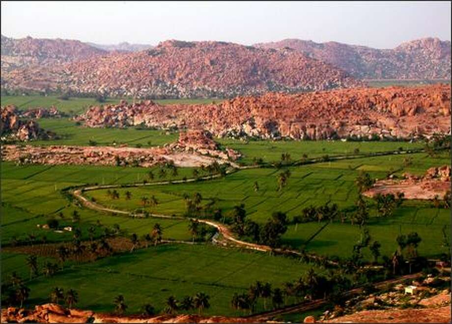 Mountains of boulders as far as the eye can see. The landscape that surrounds the village of Hampi in Southern India is a magical playground full of hidden ruins that date back to the 1300s. It's a good place to explore on foot, bicycle or scooter. We tried all three. Photo: Winda Benedetti, Special To Seattle Post-Intelligencer / Special to Seattle Post-Intelligencer