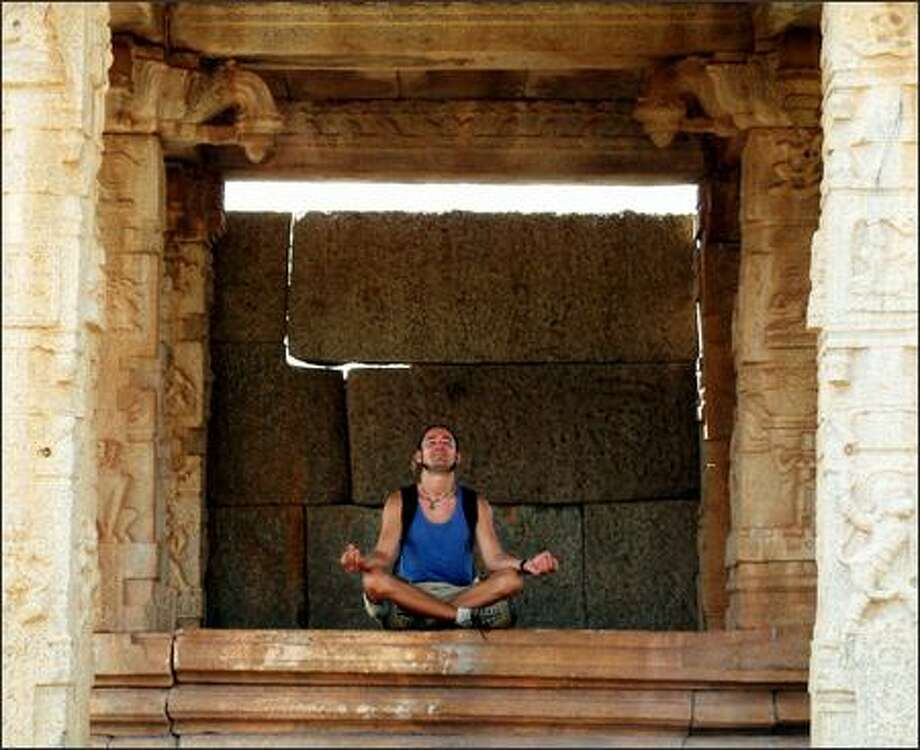 Richie finds his moment of zen in the ruins of a Vijayanagar temple near Hampi. The city of Vijayanagar, which once covered twenty square miles and was home to half a million people, was founded in the 1300s and reached the height of its power in the 1500s. Photo: Winda Benedetti, Special To Seattle Post-Intelligencer / Special to Seattle Post-Intelligencer