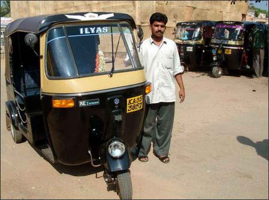 A driver with his brand new rickshaw waits to take us to our train. Motorized rickshaws (think of them as super-powered three-wheeled golf carts) are a primary mode of transportation in India. But travelers must be wary. Not all drivers are as honest as this one. Many rickshaw drivers will try to trick unwary travelers by either charging them too much money or by taking them to hotels or shops they don't want to go to. The drivers get paid by these establishments to bring in both willing and unwilling customers. Richie and I foiled more than one attempt to trick us. Photo: Winda Benedetti, Special To Seattle Post-Intelligencer / Special to Seattle Post-Intelligencer