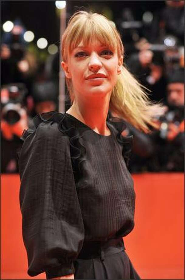 "German actress Heike Makatsch poses on the red carpet ahead of the premiere of the film ""The International"" by German director Tom Tykwer on the opening night of the 59th Berlinale Film Festival in Berlin Thursday. Photo: Getty Images / Getty Images"