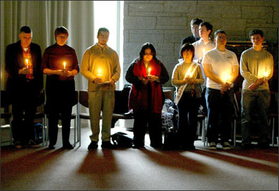 About 100 students, faculty members and staff participate in a multifaith solidarity vigil for tsunami victims and survivors at the LeRoux Conference Room in Seattle University's Student Center Photo: Joshua Trujillo, Seattlepi.com / seattlepi.com