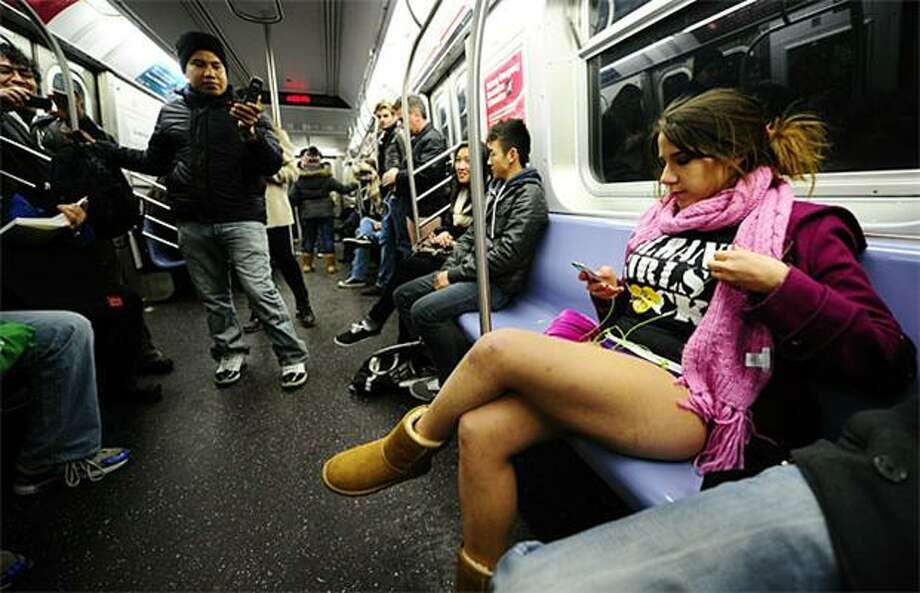 "Pantsless in the Apple: Despite sub-freezing temperatures, a young New Yorker rides the tubes in her underpants for the annual ""No Pants Subway Ride."" Hundreds stripped to the skivvies for the event while keeping their upper halves fully dressed and warm. Photo: Emmanuel Dunand, AFP / Getty Images / AFP / Getty Images"