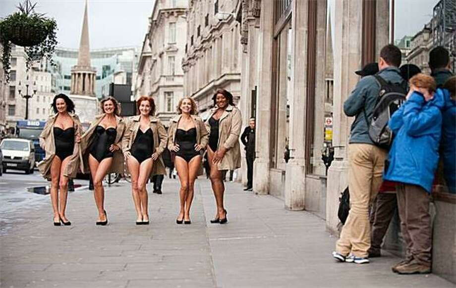Coo coo ca choo, Mrs. Robinson:Mature models promoting the launch of a home shopping brand that features a plus-size clothing line show some leg in London, seering the retinas of a young boy. Photo: Leon Neal, AFP / Getty Images / AFP / Getty Images