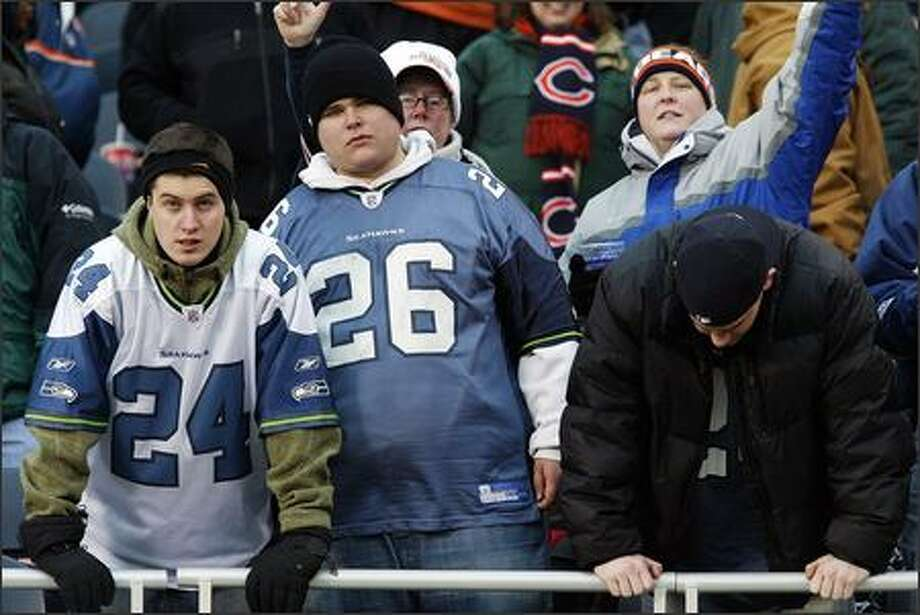 Ross Donnelly, 20, from Capitol Hill, Matt Carlson , 19, from Magnolia, and Cameron Day, 19, from Bellevue, are stunned by the Seattle Seahawks' defeat to the Chicago Bears in overtime during Divisional Playoffs at Soldier Field in Chicago.  The Bears won 27-24. Photo: Mike Urban, Seattle Post-Intelligencer / Seattle Post-Intelligencer