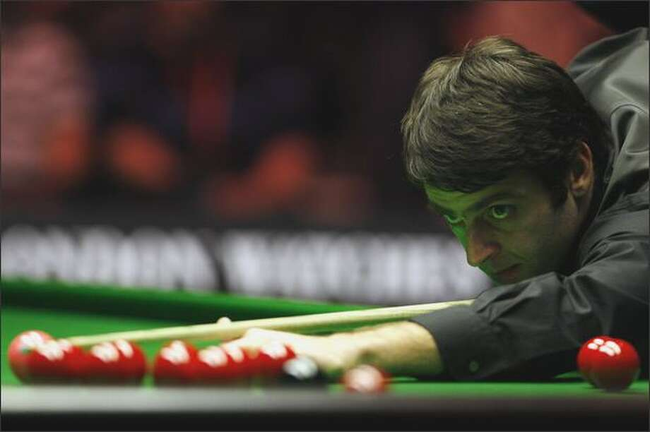 Ronnie O'Sullivan of England plays a shot during the Masters Snooker final against Mark Selby of England at Wembley Conference Centre in London on Sunday. Photo: Getty Images / Getty Images