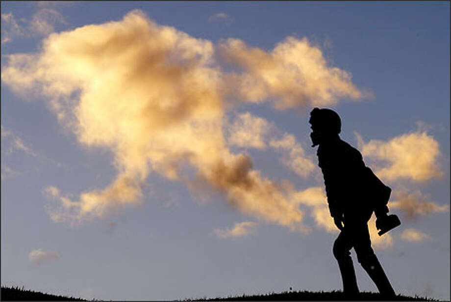 David Broecker strides up the hills at Seattle's Gas Works Park at sunset. Photo: Scott Eklund, Seattle Post-Intelligencer / Seattle Post-Intelligencer