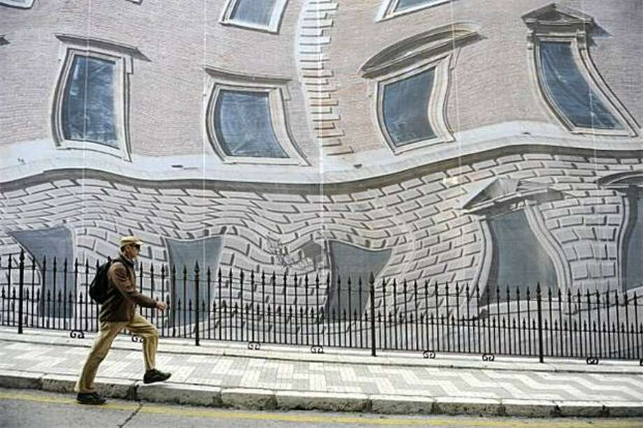 After eating a bowl of peculiar-tasting vichyssoise for lunch, Juan heads back to work:A construction site scaffolding in Malaga, Spain, is hidden by a massive sheet printed to look like a building. Photo: Odd Andersen, AFP / Getty Images / AFP / Getty Images