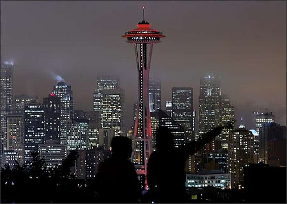 """The Space Needle is bathed in red light Thursday night to kick off Friday's National Wear Red for Women Day. The designation is aimed at raising awareness of cardiovascular diseases, the No. 1 killer of women. Among other iconic structures """"going red"""" were the Washington Monument and New York's Empire State Building. Photo: Dan DeLong, Seattle Post-Intelligencer / Seattle Post-Intelligencer"""