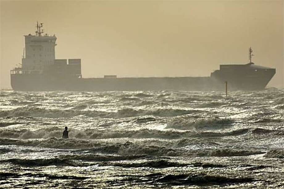 "No lifeguard on duty:Windswept waves lash one of artist Antony Gormley's life-size ""Another Place"" statues at Crosby Beach, England. Photo: Christopher Furlong, Getty Images / Getty Images"