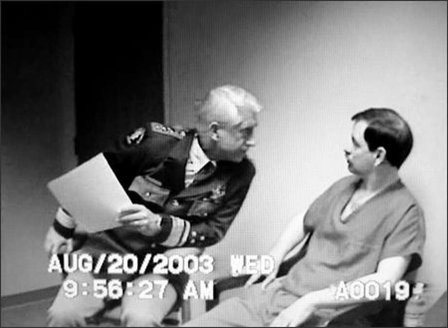 King County Sheriff Dave Reichert, left, stares intently at Green River Killer Gary Leon Ridgway, right, in this image from video taken from an Aug. 20, 2003, interrogation of Ridgway. The image is from more than 400 hours of Ridgway video released Monday by the King County Prosecutor's Office in Seattle. Ridgway pleaded guilty in 2003 to 48 counts of aggrevated first-degree murder in killings from 1982-1991. (AP Photo/Courtesy King Co. Prosecutor's Office) Photo: Associated Press / Associated Press