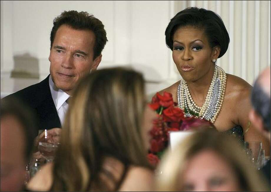 First lady Michelle Obama chats with California Governor Arnold Schwarzenegger during the 2009 Governors Dinner at the White House. Photo: Getty Images / Getty Images