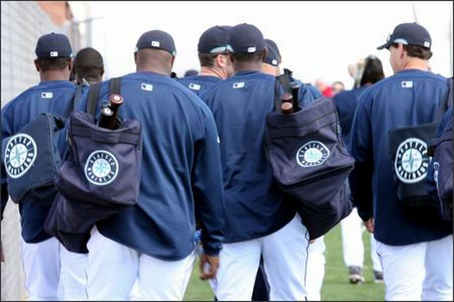 Seattle Mariners players and coaches head to the clubhouse after finishing practice on Friday in Peoria, Ariz. Photo: Grant M. Haller, Seattle Post-Intelligencer / Seattle Post-Intelligencer
