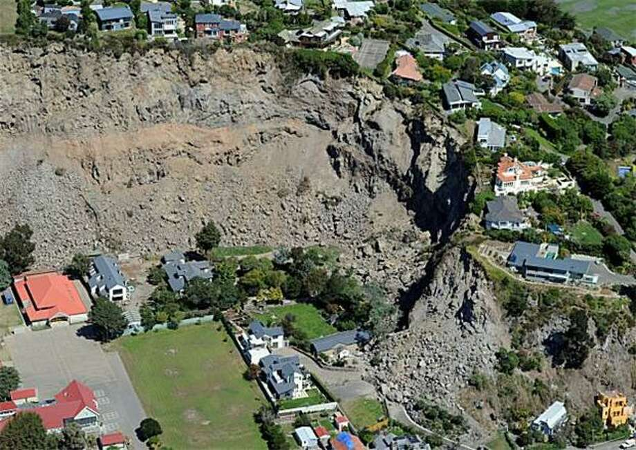 Less acreage in an instant:A landslide caused by Tuesday's earthquake in Christchurch, New Zealand, wiped out the backyards of several luxury hilltop homes in Sumner. Photo: Torsten Blackwood, AFP / Getty Images / AFP / Getty Images
