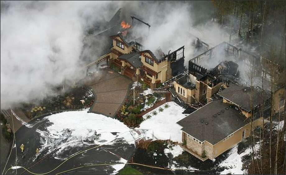 Eco-terrorists are suspected in using explosive devises to destroy or damage several Street of Dreams show homes, which burned in Woodinville. Photo: Dan DeLong, Seattle Post-Intelligencer / Seattle Post-Intelligencer