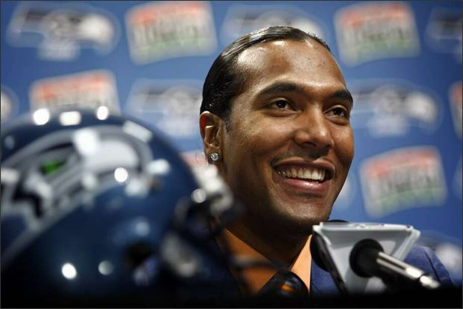 The Seahawks introduce T.J. Houshmandzadeh as their newest wide receiver during a press conference at Seahawks headquarters in Renton Tuesday. Photo: Andy Rogers, Seattle Post-Intelligencer / Seattle Post-Intelligencer