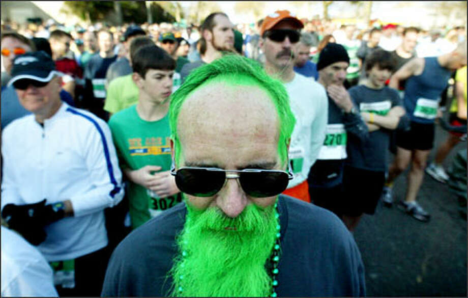 Bill Joyce of Mountlake Terrace sports the spirit and color of the day as he waits on Mercer Street for the start of the annual St. Patrick's Day Dash. The green-coifed Joyce, whose hair was colored by granddaughter Antonia Joyce, was one of 11,750 people who participated in the race Sunday. Photo: Dan DeLong, Seattle Post-Intelligencer / Seattle Post-Intelligencer