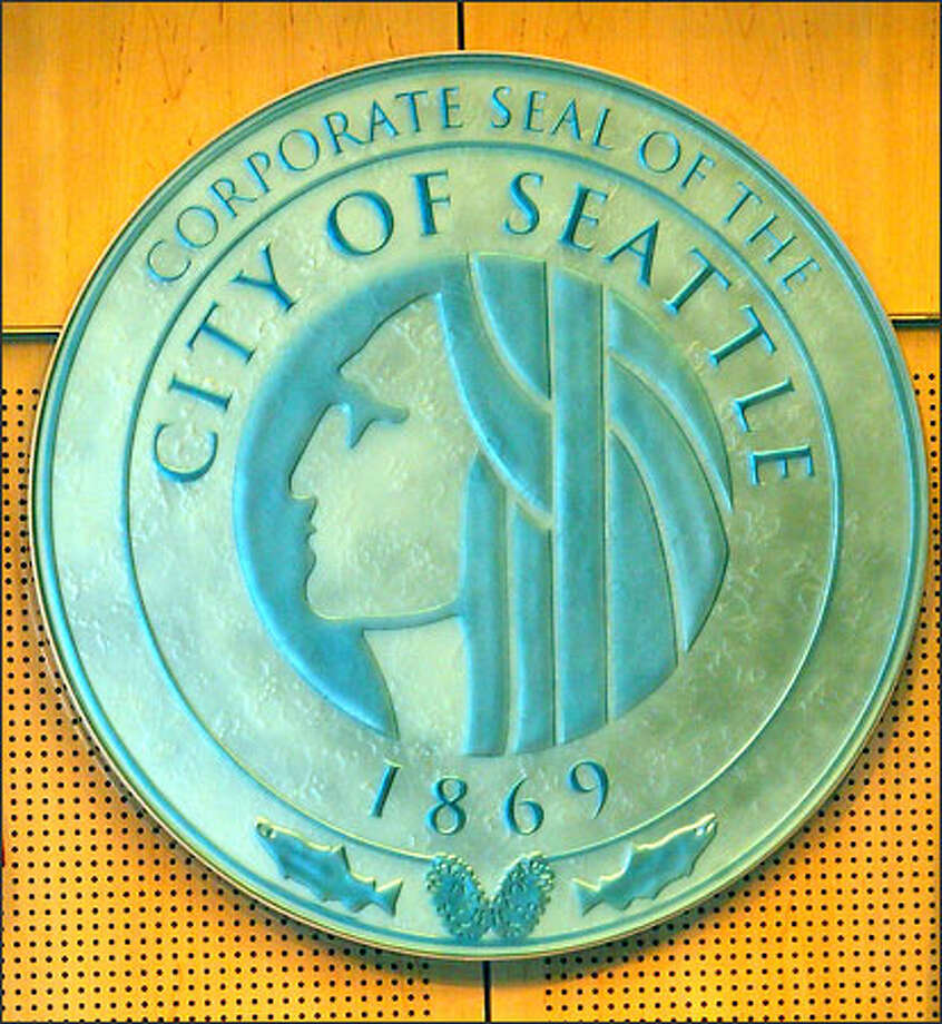 Seattle's new corporate seal, designed by glass artist Peter David, was unveiled at a ceremony celebrating the heritage of Chief Seattle, whose father was from the Suquamish Tribe and whose mother was from the Duwamish. Photo: Dan DeLong, Seattle Post-Intelligencer / Seattle Post-Intelligencer