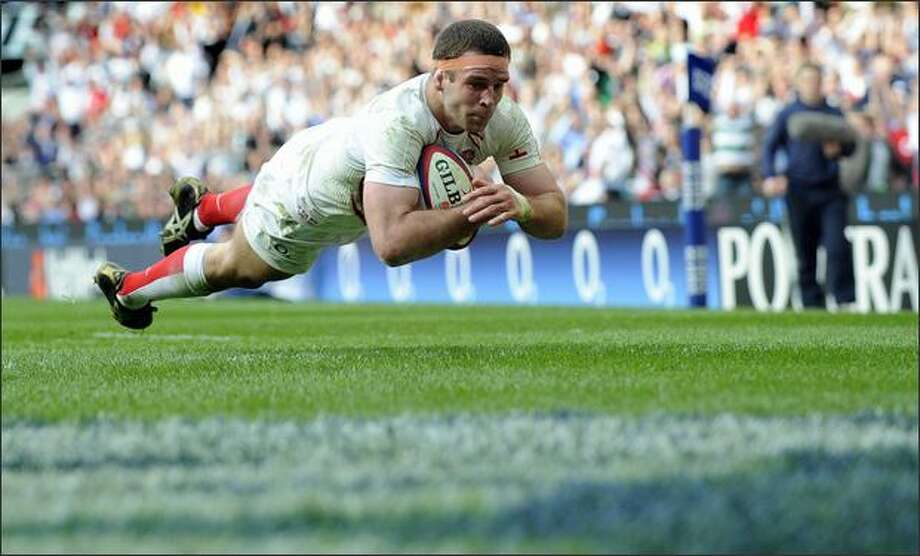 England's flanker Joe Worsley scores a try during their Six Nations rugby union match against France on Sunday at the Twickenham Stadium in London. Photo: Getty Images / Getty Images