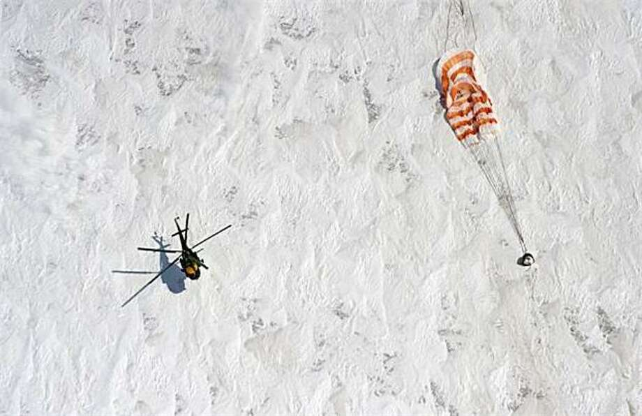 Heres's our ride now: A Russian space agency helicopter lands near the Soyuz capsule with Russian cosmonauts Oleg Skripochka, Alexander Kaleri and U.S. astronaut Scott Kelly aboard. The trio landed safely in the snowy expanses of central Kazakhstan after spending a 5-month hitch on the International Space Station. Photo: Dmitry Kostyukov, AP / AP