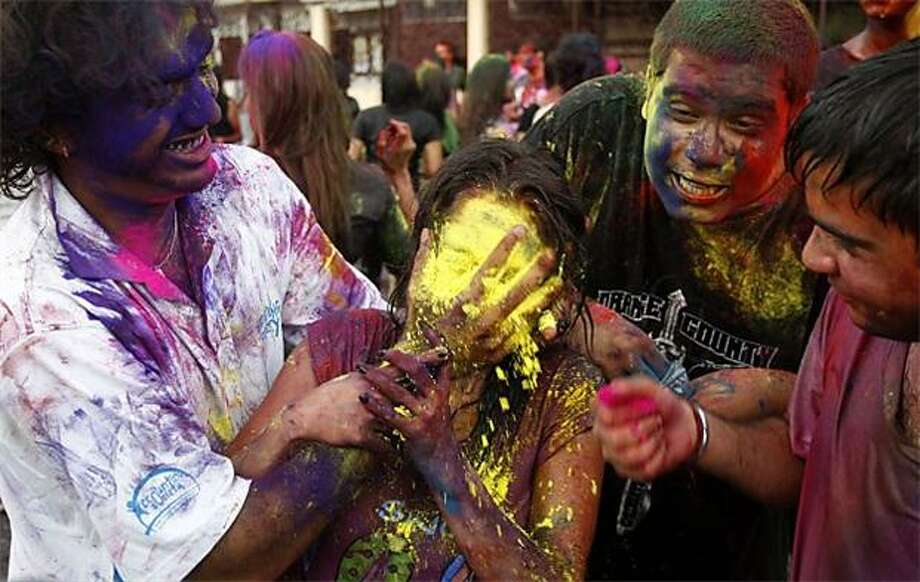 Powder to the people: A Hindu devotee mashes pigment into a fellow celebrant's face at the Holi festival of colors in Kuala Lumpur. Photo: Lai Seng Sin, AP / AP