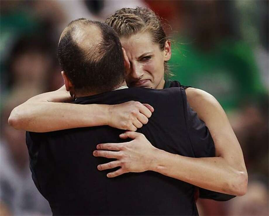 Emotional moment: From the expression on guard Celeste Hoewisch's face, one might think that Wisconsin-Green Bay coach Matt Bollant's team lost its NCAA tournament game against Michigan State. Instead, the Phoenix defeated the Spartans, 65-56, to advance to the Sweet Sixteen. Photo: Orlin Wagner, AP / AP